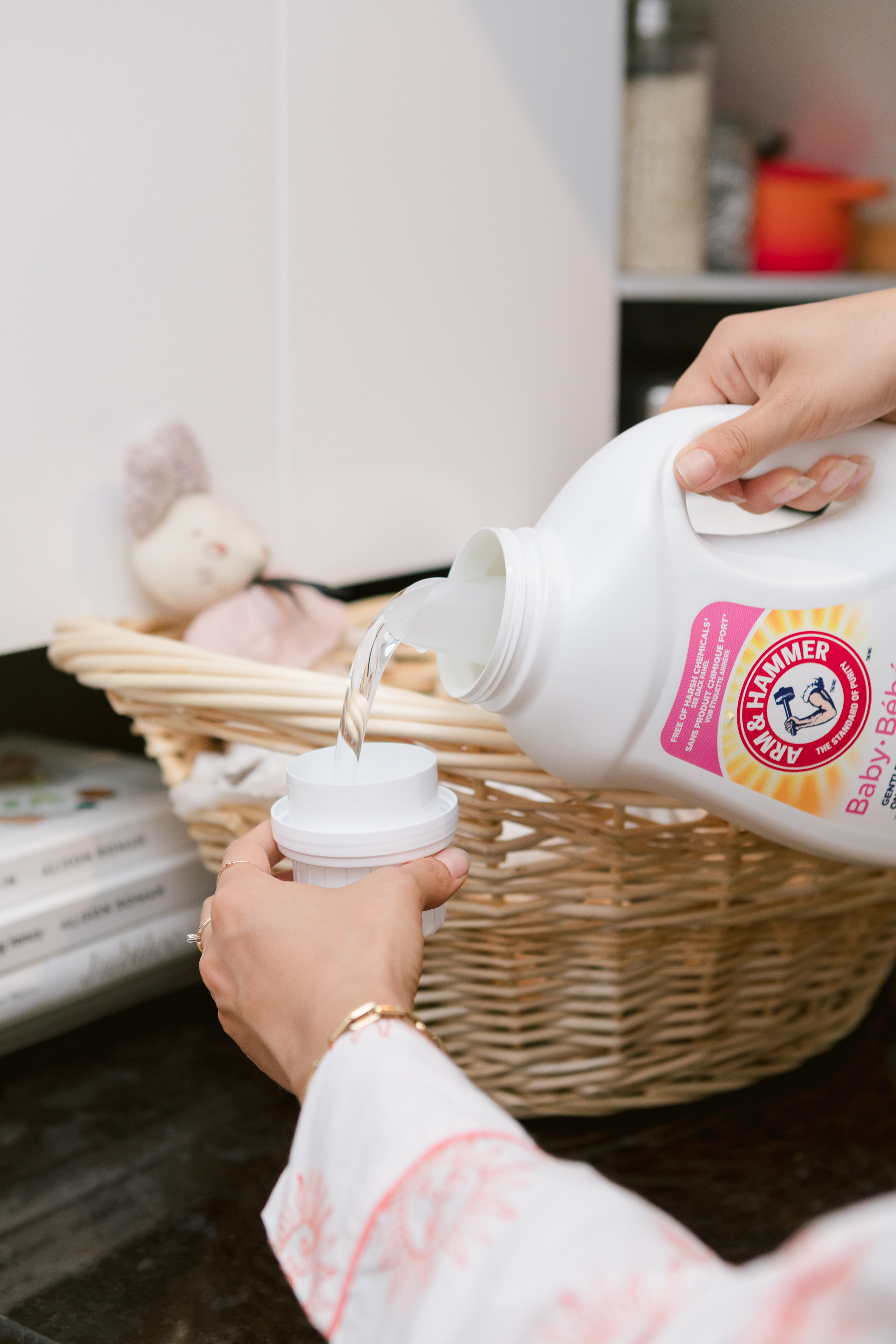 Pouring laundry detergent into the cup