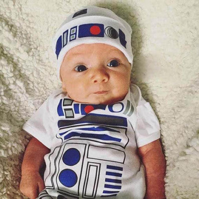 Baby wearing R2d2 onesie and hat