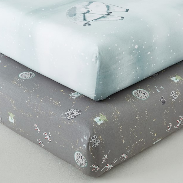 Pottery Barn Star Wars crib sheets featuring the Death Star, TIE fighters, X-Wings, Yoda, and the Millennium Falcon